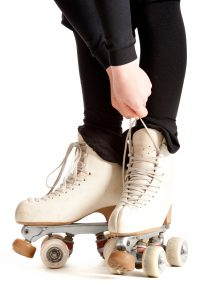 girl with roller skates isolated on white background