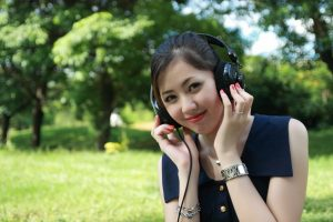 Woman listening to headphones outside