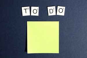 "Flat lay of sticky note with letter tiles spelling ""to do"""
